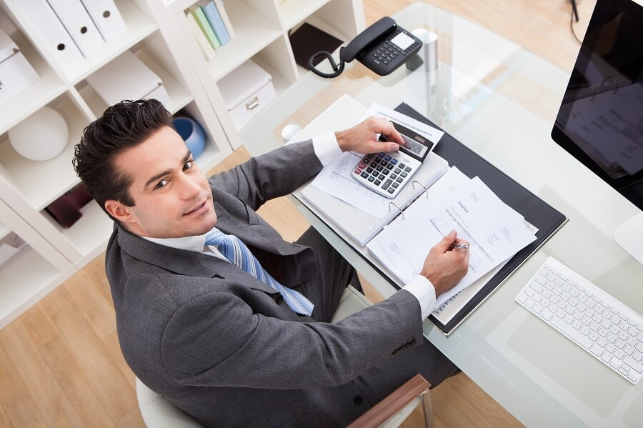 businessman looking up from his desk