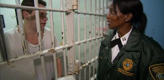 inmate having a conversation with a correctional officer