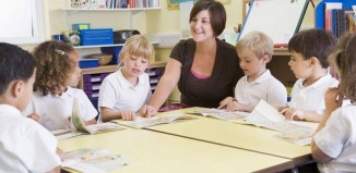 a primary education teacher with her students
