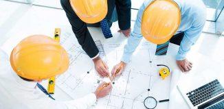 three civil engineers working on a plan
