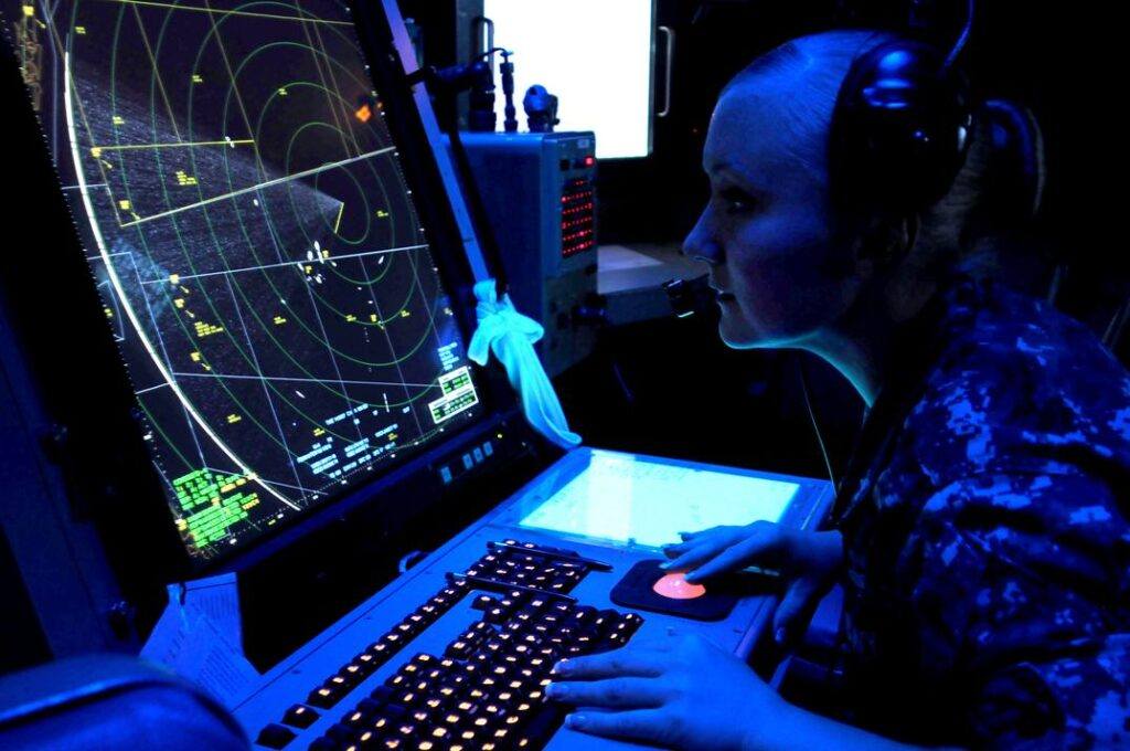 120627-N-NR998-919  ATLANTIC OCEAN (June 27, 2012) Air-Traffic Controller 2nd Class Karina Reid operates the SPN-43 air search radar system while standing approach control aboard the amphibious assault ship USS Wasp (LHD 1). Wasp is participating in the War of 1812 fleet exercise, a week-long multi-national exercise involving 19 ships from the United States, Canada, the United Kingdom, Germany, Norway, Denmark, Brazil, and Portugal, and is designed to increase interoperability with allied nations, improve tactical prowess and certification of participating units. (U.S. Navy photo by Mass Communication Specialist Petty Officer 2nd Class Gretchen M. Albrecht/Released)