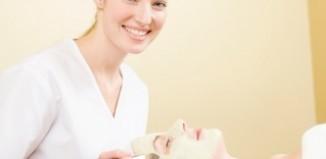 Esthetician providing a facial treatment to a client