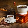 coffee grinder, coffee beans and a nice cup of coffee