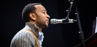 John Legend singing and playing the piano
