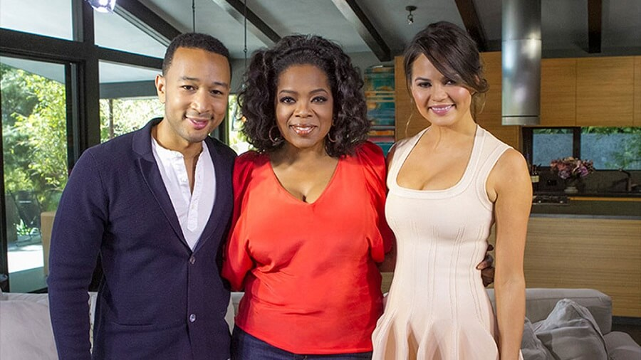 john legend posing with his wife and oprah