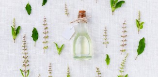 natural oil bottle surrounded by leaves alternative to parabens