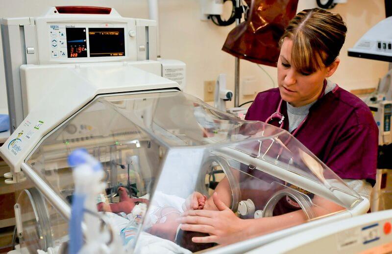midwife nurse examining a newborn