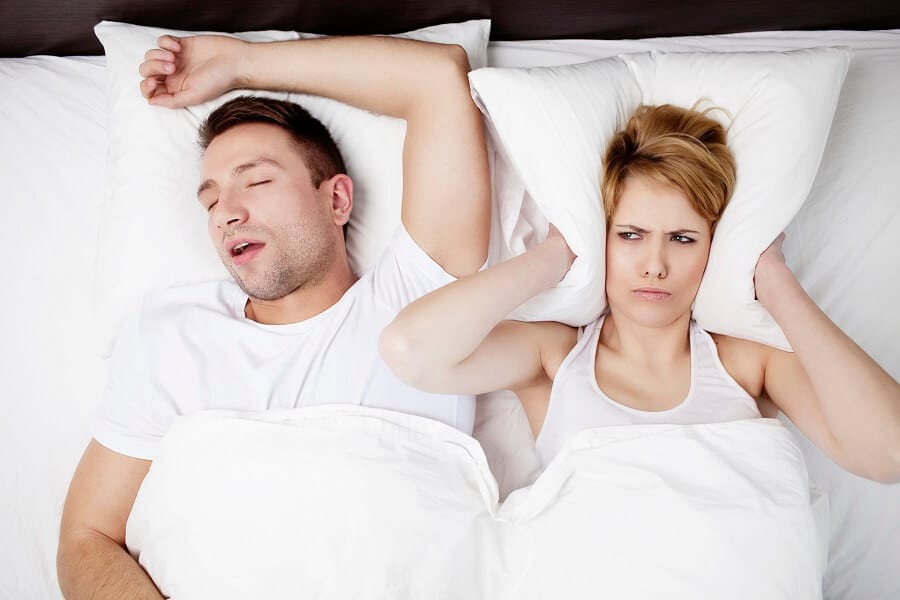 man snoring and irritating his partner