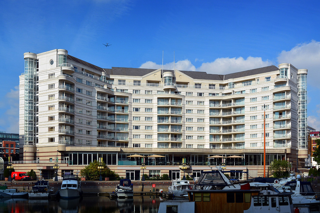 Outdoor View of Five star hotel and yacht marina built on a coal dock yard at London Borough to better understand Your Options on Hotel vs. Motel