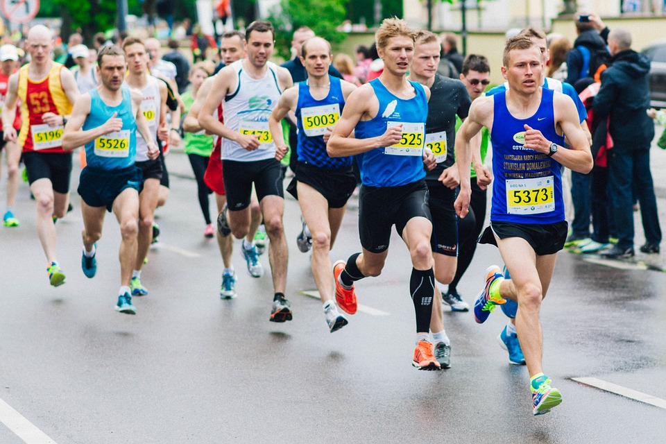 Race Marathon Runners on a league that shows kinetic energy exerted