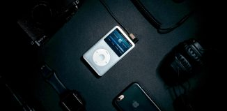 ipod in the middle of other gadgets and personal accessories