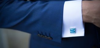 Man wearing a blue suit with a blue cufflinks
